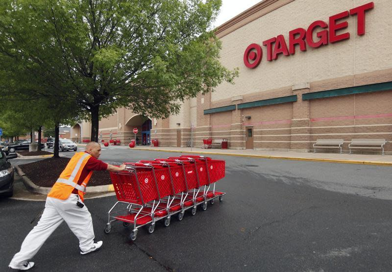 A Target employee returns carts to the store in Falls Church