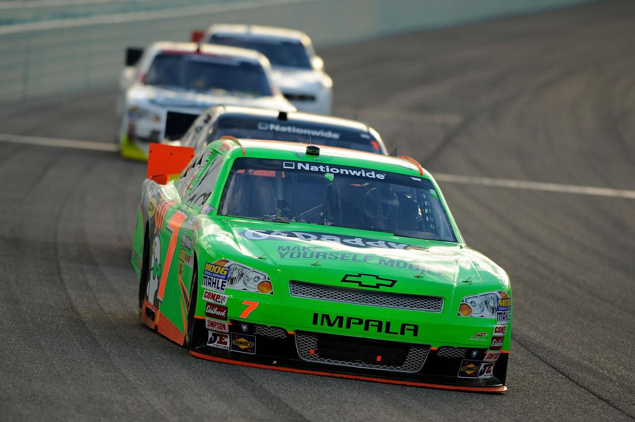HOMESTEAD, FL - NOVEMBER 17:  Danica Patrick, driver of the #7 GoDaddy.com Chevrolet, leads a group of cars during the NASCAR Nationwide Series Ford EcoBoost 300 at Homestead-Miami Speedway on November 17, 2012 in Homestead, Florida.  (Photo by Jared C. Tilton/Getty Images for NASCAR)