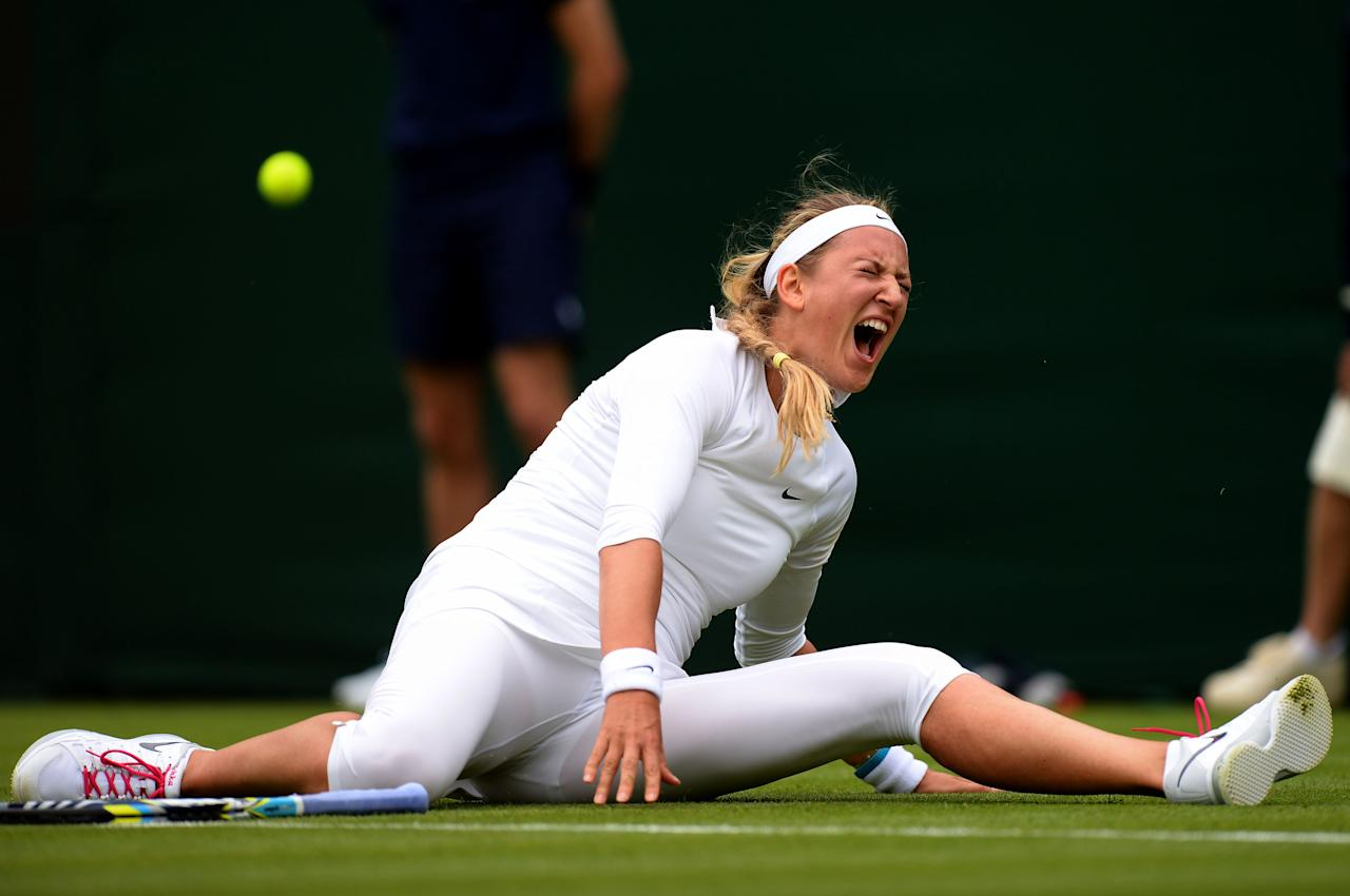 Belarus' Victoria Azarenka slips during her match against Portugal's Maria Joao Koehler during day one of the Wimbledon Championships at The All England Lawn Tennis and Croquet Club, Wimbledon.