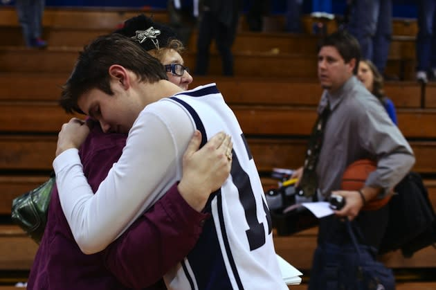 Davan Overton, a basketball player who suffers from Dandy-Walker Syndrome, hugs his mother after a game — The Oregonian