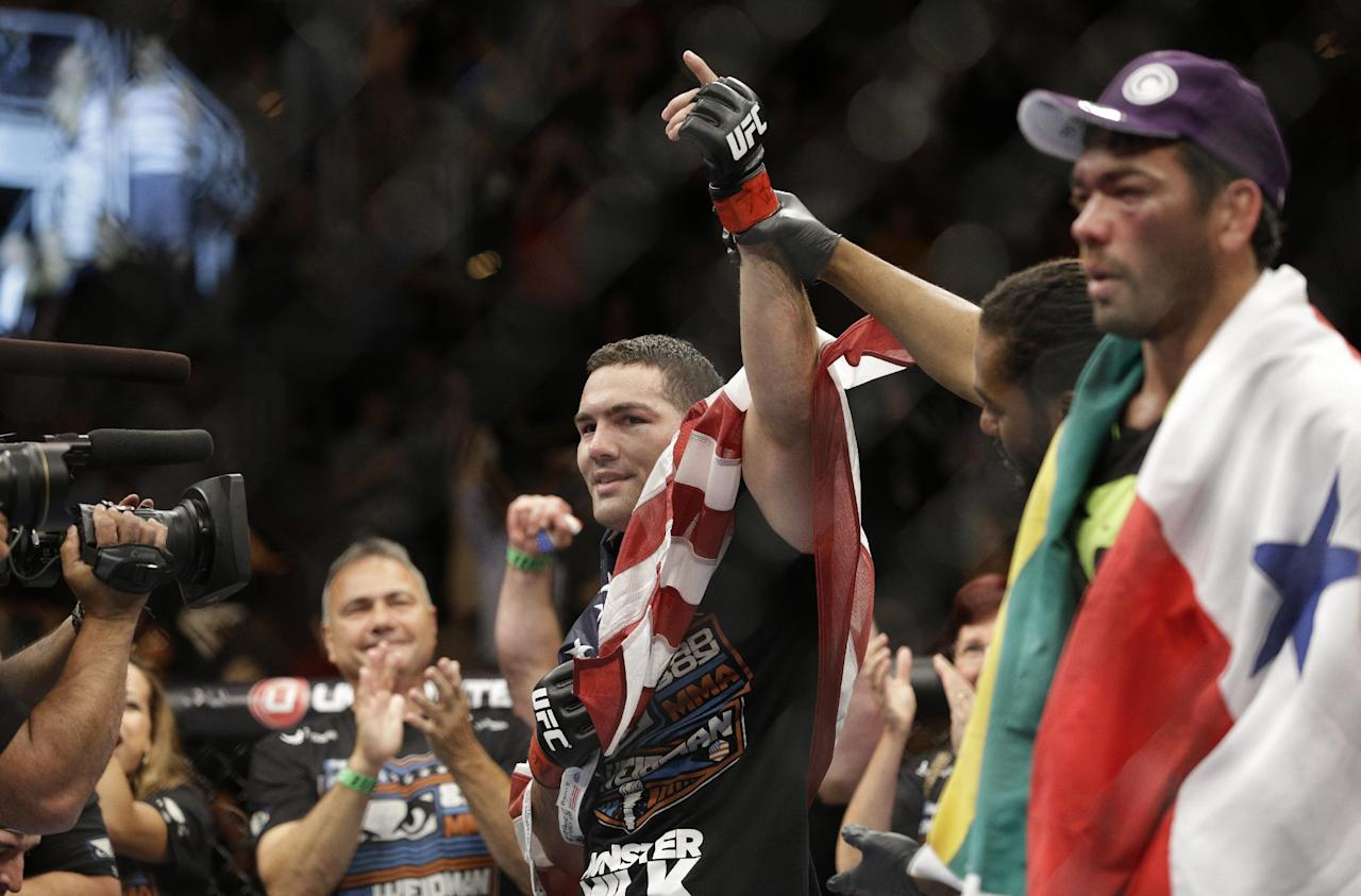 Chris Weidman celebrates after defeating Lyoto Machida, right, in their mixed martial arts middleweight title bout at UFC 175 Saturday, July 5, 2014, in Las Vegas. (AP Photo/John Locher)