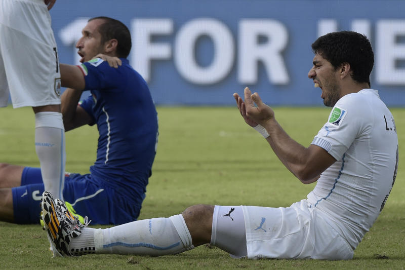 Uruguay's forward Luis Suarez reacts during a Group D football match between Italy and Uruguay at the Dunas Arena in Natal during the 2014 FIFA World Cup on June 24, 2014