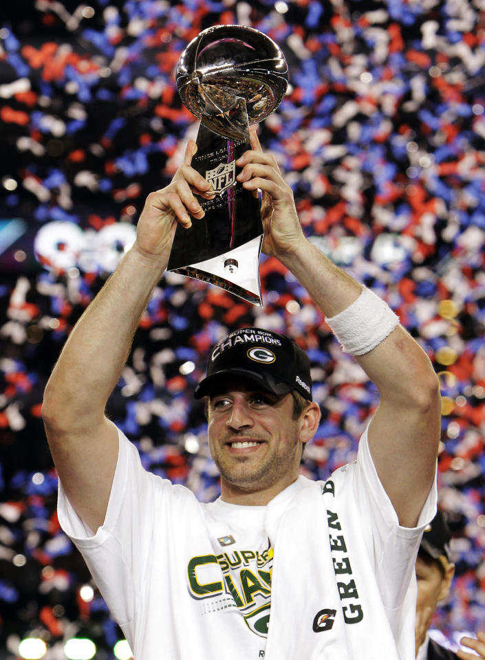 FILE - In this Feb. 6, 2011, file photo, Green Bay Packers quarterback Aaron Rodgers holds the Vince Lombardi Trophy after the Packers' 31-25 win over the Pittsburgh Steelers in the NFL Super Bowl XLV football game in Arlington, Texas. Rodgers is the 2011 Male Athlete of the Year chosen by members of The Associated Press after his MVP performance in the Green Bay Packers' Super Bowl victory in February and his stellar play during the team's long unbeaten run this season. (AP Photo/Mark Humphrey, File)
