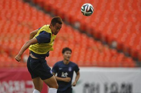 South Korea's Kim Shin-wook jumps for a header during a training session at the Sun Life stadium of Miami