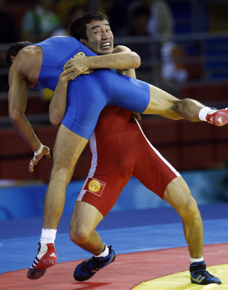 Kyrgyzstan's Kanatbek Begaliev, back, flips Ukraine's Armen Vardanyan during their 66 kilogram greco-roman wrestling match at the Beijing 2008 Olympics in Beijing, Wednesday, Aug. 13, 2008.  (AP Photo/Ed Wray)