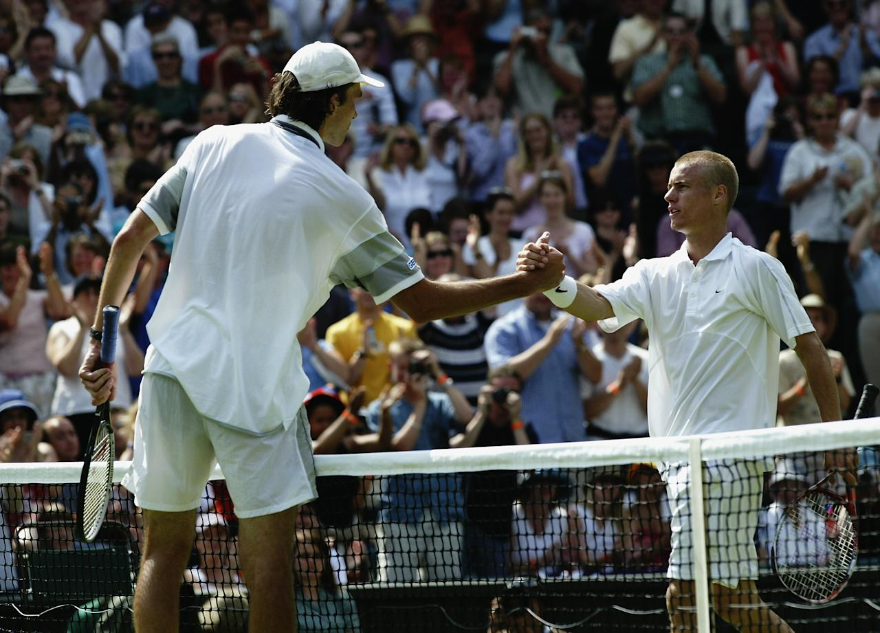 LONDON - JUNE 23:  Ivo Karlovic of Croatia shakes hands at the net after beating defending champion Lleyton Hewitt of Australia during the opening day of the Wimbledon Lawn Tennis Championships held on June 23, 2003 at the All England Lawn Tennis and Croquet Club, in Wimbledon, London. (Photo by Alex Livesey/Getty Images)