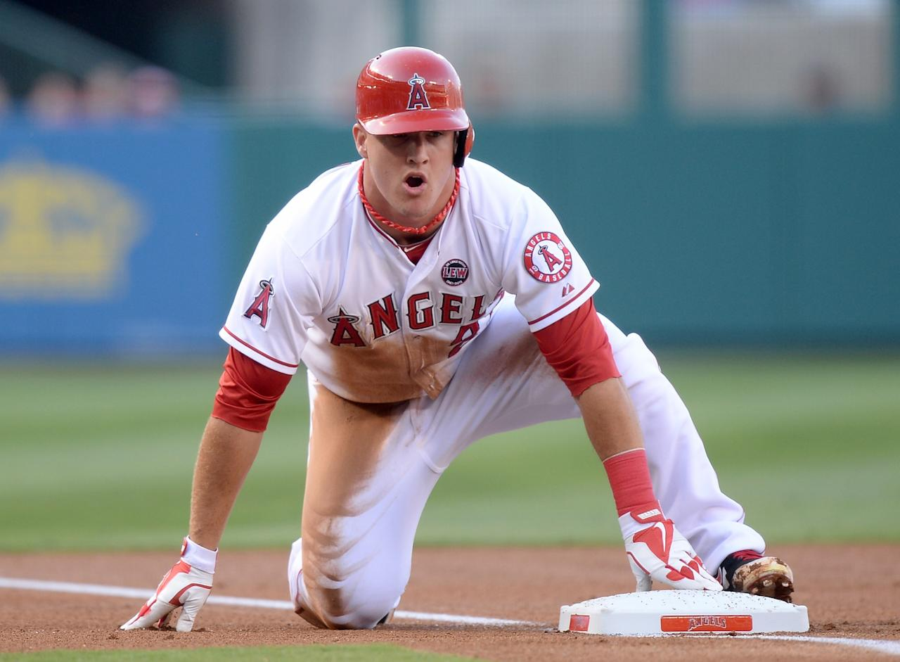ANAHEIM, CA - JULY 20: Mike Trout #27 of the Los Angeles Angels reacts after taking third on a Albert Pujols #5 single during the first inning against the Oakland Athletics at Angel Stadium of Anaheim on July 20, 2013 in Anaheim, California. (Photo by Harry How/Getty Images)