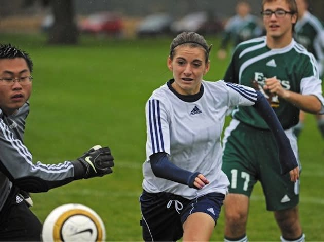 Tacoma Baptist boys soccer star Becca McDonald directs a ball toward goal — News Tribune