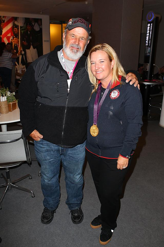 U.S. Olympic gold medalist Kimberly Rhode stops for a photo with her father Richard Rhode at the USOC Function at the USA House at the Royal College of Art on July 29, 2012 in London, England.  (Photo by Joe Scarnici/Getty Images)