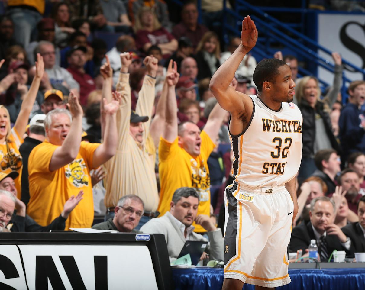 Wichita State guard Tekele Cotton reacts after hitting a three-point shot in second half action during the Missouri Valley Conference tournament championship game between Wichita State and Indiana State on Sunday, March 9, 2014, at the Scottrade Center in St. Louis. (AP Photo/St. Louis Post-Dispatch, Chris Lee) EDWARDSVILLE INTELLIGENCER OUT; THE ALTON TELEGRAPH OUT