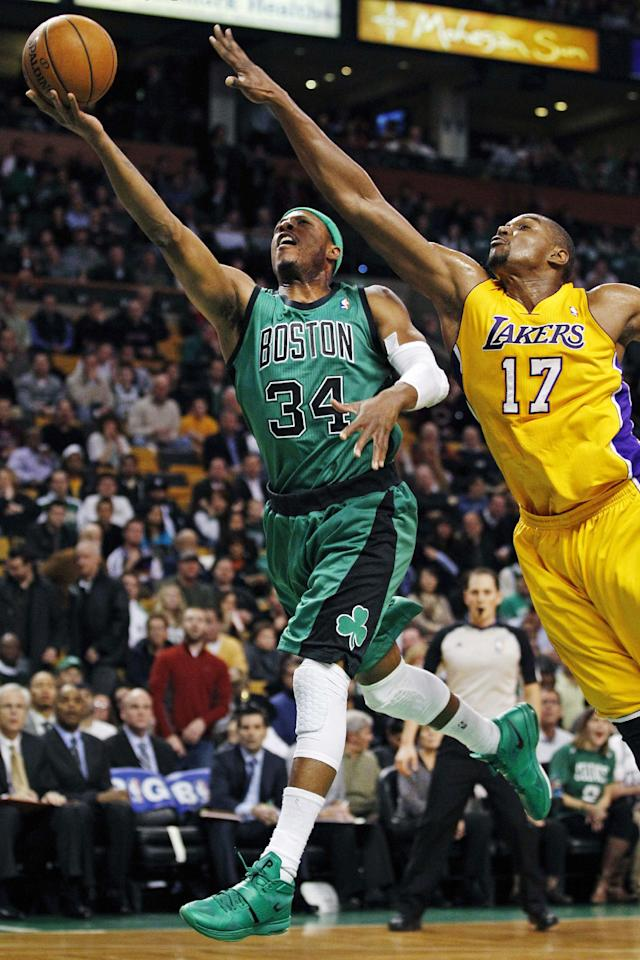Boston Celtics forward Paul Pierce (34) drives to the basket past Los Angeles Lakers center Andrew Bynum (17) during the first quarter of an NBA basketball game in Boston, Thursday Feb. 9, 2012. (AP Photo/Charles Krupa)