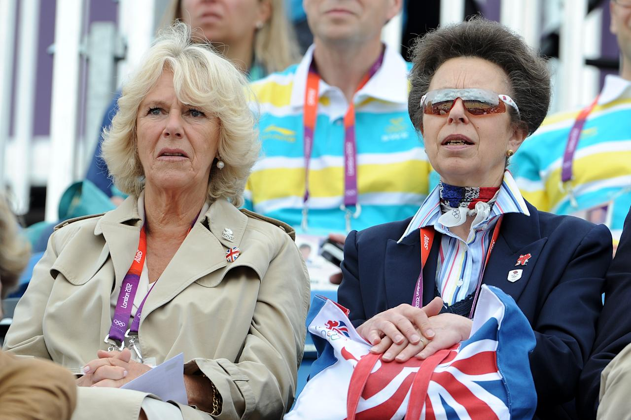 Camilla, Duchess of Cornwall and Princess Anne, Pricess Royal at the Show Jumping Eventing Equestrian on Day 4 of the London 2012 Olympic Games at Greenwich Park on July 31, 2012 in London, England.  (Photo by Pascal Le Segretain/Getty Images)