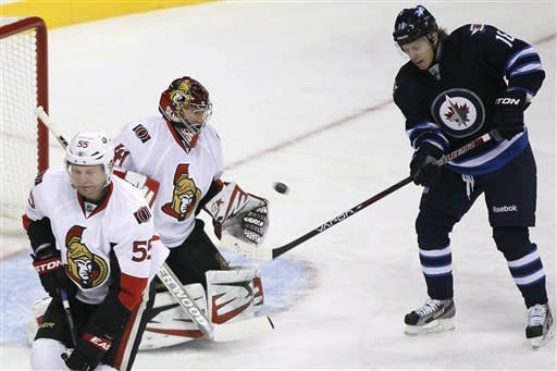 Senators top Jets 4-1 in season opener