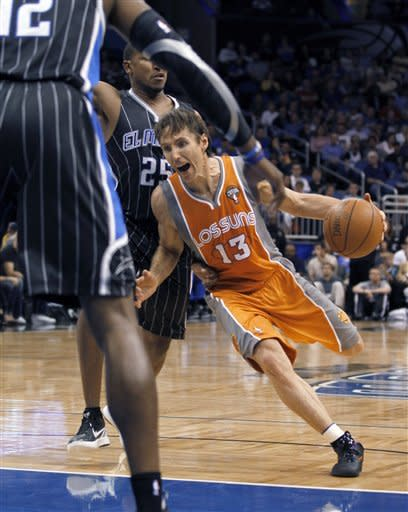 Phoenix Suns guard Steve Nash (13) drives past Orlando Magic guard Chris Duhon (25) during the first half of an NBA basketball game Wednesday, March 21, 2012, in Orlando Fla. (AP Photo/Reinhold Matay)