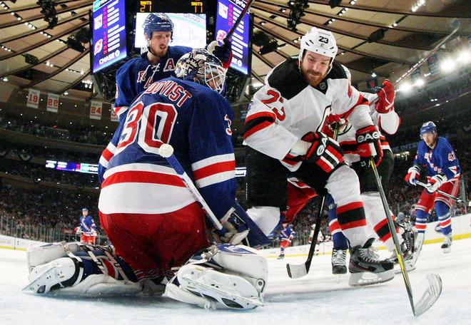 NEW YORK, NY - MAY 23:  Henrik Lundqvist #30 of the New York Rangers defends against David Clarkson #23 of the New Jersey Devils in the third period of Game Five of the Eastern Conference Final during the 2012 NHL Stanley Cup Playoffs at Madison Square Garden on May 23, 2012 in New York City.  (Photo by Bruce Bennett/Getty Images)