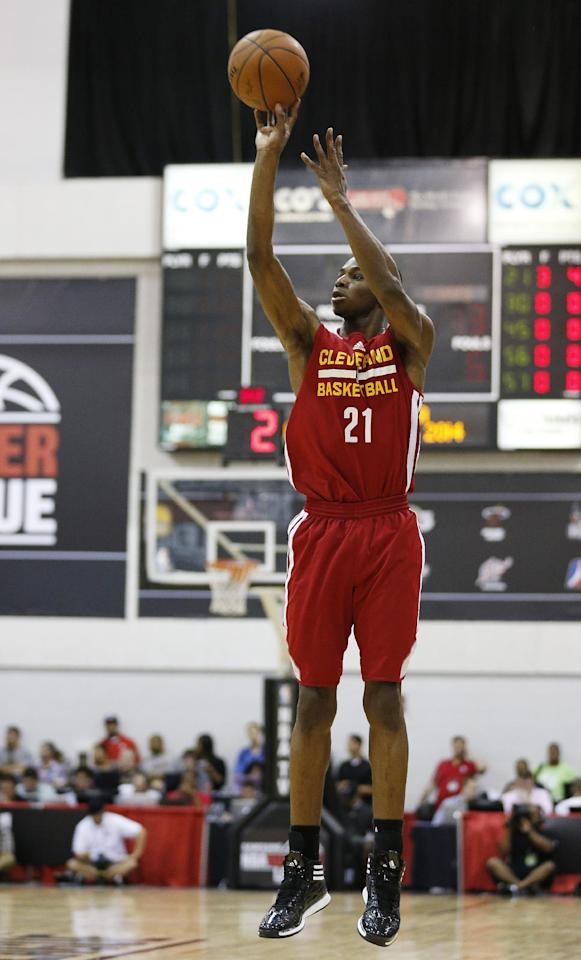 Andrew Wiggins of the Cleveland Cavaliers takes a shot against the Milwaukee Bucks in an NBA summer league basketball Friday, July 11, 2014, in Las Vegas. (AP Photo/John Locher)