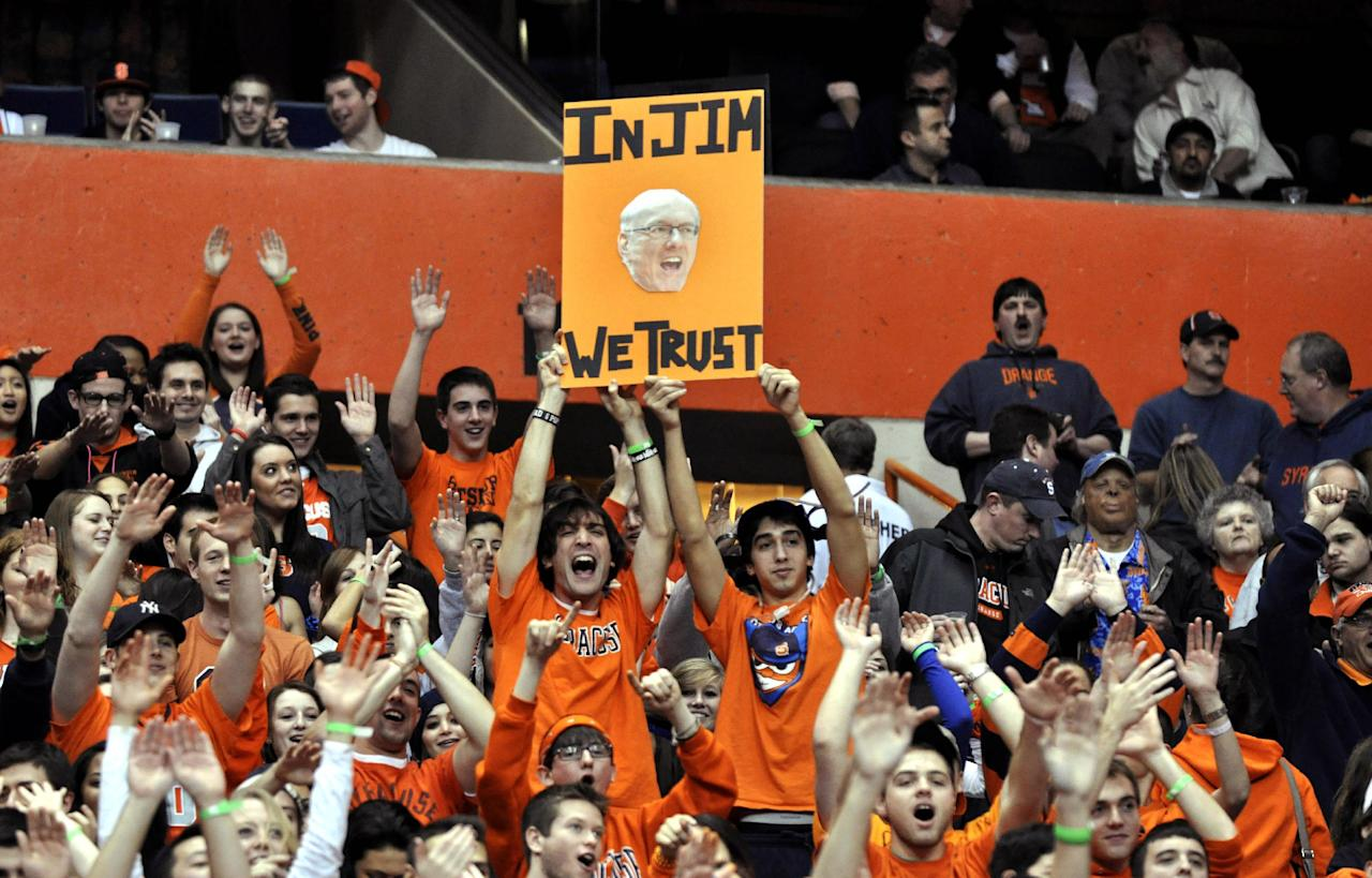 Syracuse students hold a sign during introductions before tan NCAA college basketball game against Florida in Syracuse, N.Y., Friday, Dec. 2, 2011. (AP Photo/Kevin Rivoli)
