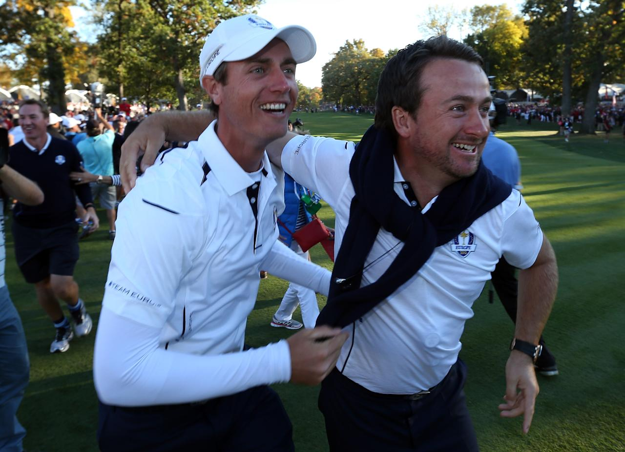 MEDINAH, IL - SEPTEMBER 30:  Nicolas Colsaerts (L) and Graeme McDowell celebrate after Europe defeated the USA 14.5 to 13.5 to retain the Ryder Cup during the Singles Matches for The 39th Ryder Cup at Medinah Country Club on September 30, 2012 in Medinah, Illinois.  (Photo by Andy Lyons/Getty Images)