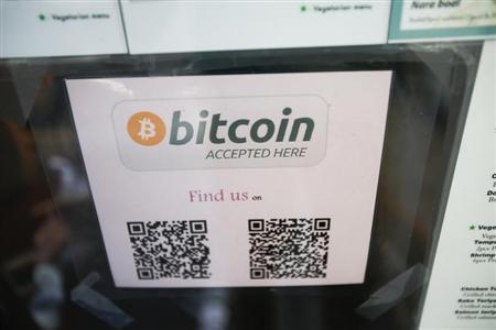 A Bitcoin logo is seen at the window of Nara Sushi, a restaurant that accepts Bitcoin as payment in San Francisco