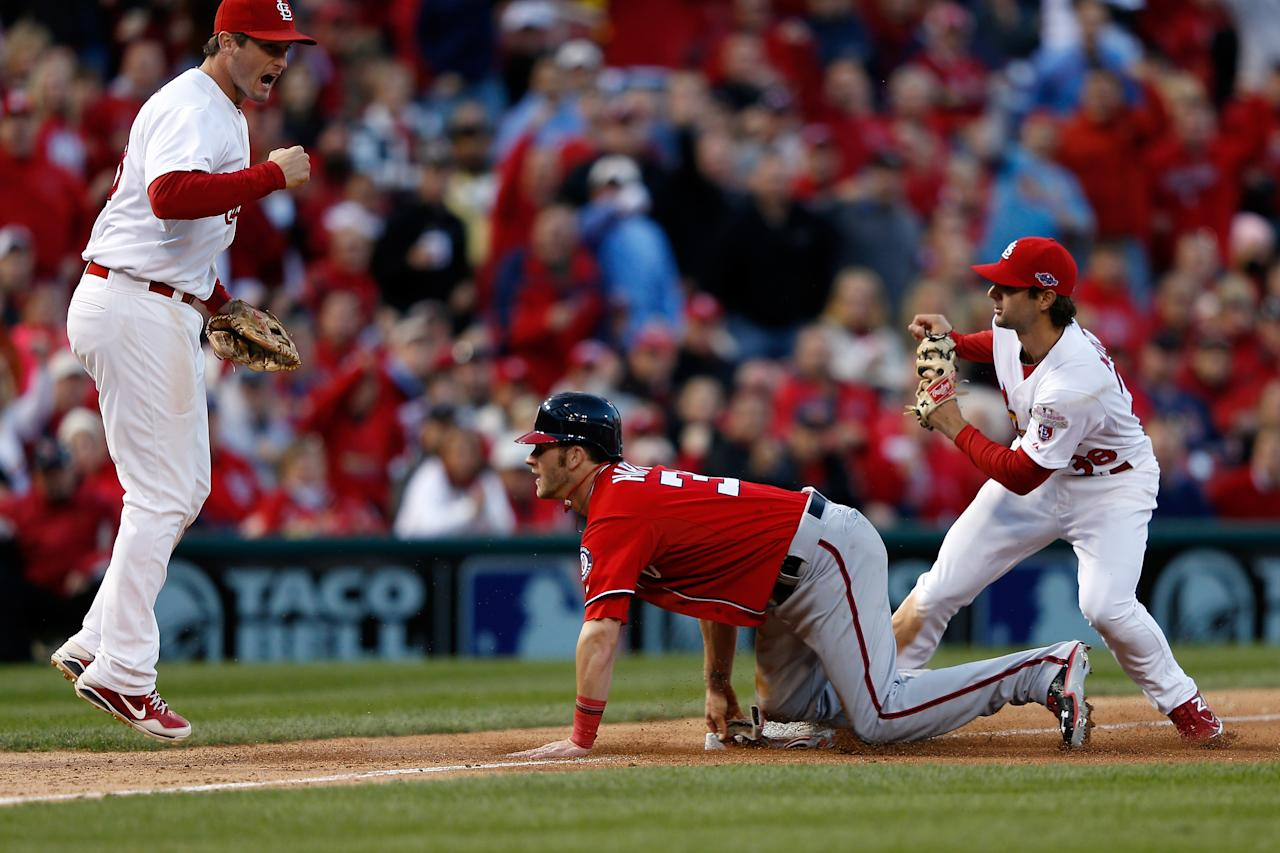 ST LOUIS, MO - OCTOBER 08:  Pete Kozma #38 of the St. Louis Cardinals tags out Bryce Harper #34 of the Washington Nationals at third base as David Freese #23 reacts in the seventh inning during Game Two of the National League Division Series at Busch Stadium on October 8, 2012 in St Louis, Missouri.  (Photo by Jamie Squire/Getty Images)