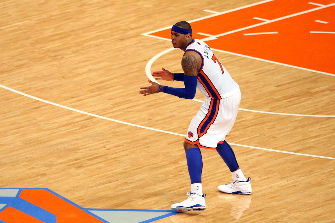 NEW YORK, NY - MAY 06:  Carmelo Anthony #7 of the New York Knicks reacts after he made a 3-point shot to put thew Knicks up 87-84 in the fourth quarter in Game Four of the Eastern Conference Quarterfinals in the 2012 NBA Playoffs on May 6, 2012 at Madison Square Garden in New York City. NOTE TO USER: User expressly acknowledges and agrees that, by downloading and or using this photograph, User is consenting to the terms and conditions of the Getty Images License Agreement  (Photo by Chris Chambers/Getty Images)