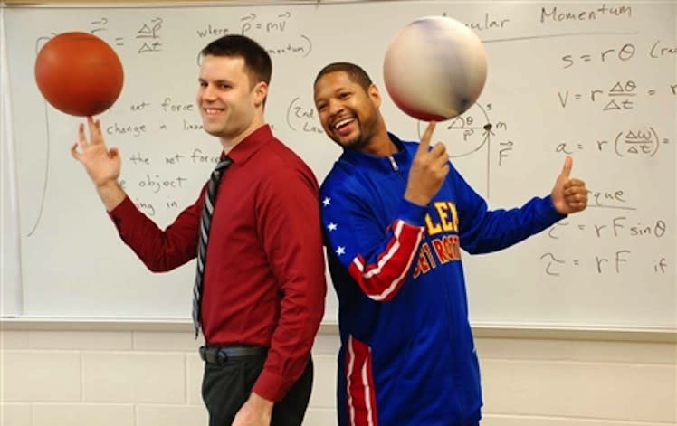 Harlem Globetrotter Handles Franklin (right) visits high school teacher Dave Hovan's physics class -- stjohnschs.org