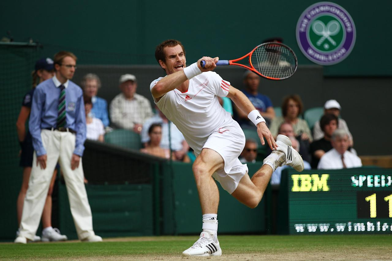 LONDON, ENGLAND - JULY 04:  Andy Murray of Great Britain hits a forehand return during his Gentlemen's Singles quarter final match against David Ferrer of Spain on day nine of the Wimbledon Lawn Tennis Championships at the All England Lawn Tennis and Croquet Club on July 4, 2012 in London, England.  (Photo by Clive Brunskill/Getty Images)