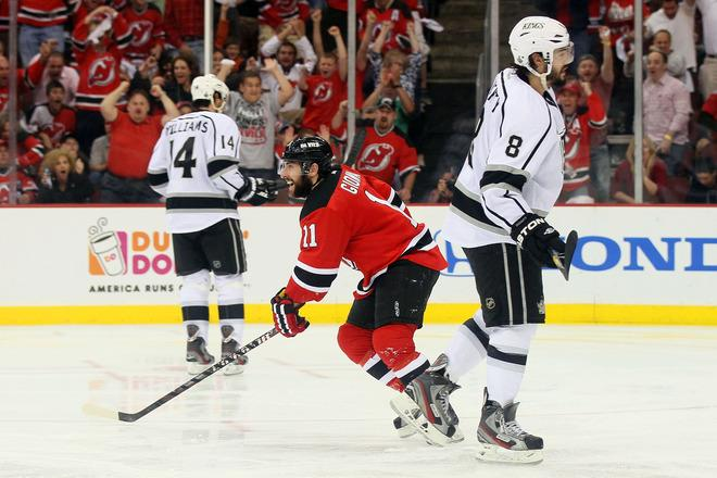 NEWARK, NJ - JUNE 02:  Stephen Gionta #11 of the New Jersey Devils reacts after a goal in the third period as Justin Williams #14 and Drew Doughty #8 of the Los Angeles Kings of the Los Angeles Kings look on during Game Two of the 2012 NHL Stanley Cup Final at the Prudential Center on June 2, 2012 in Newark, New Jersey.  (Photo by Elsa/Getty Images)