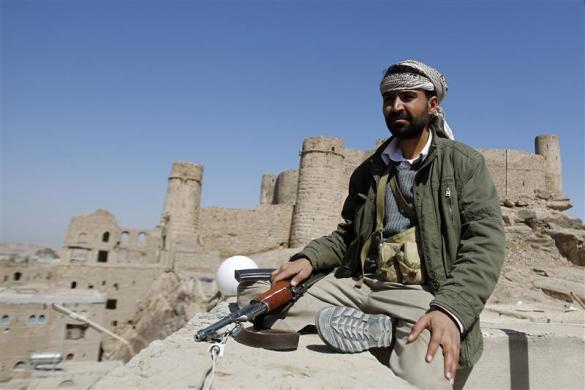 A tribesman sits on the roof of a building near a historic castle in Radda town, about 170 km (105 miles) southeast of the Yemeni capital Sanaa, January 25, 2012.