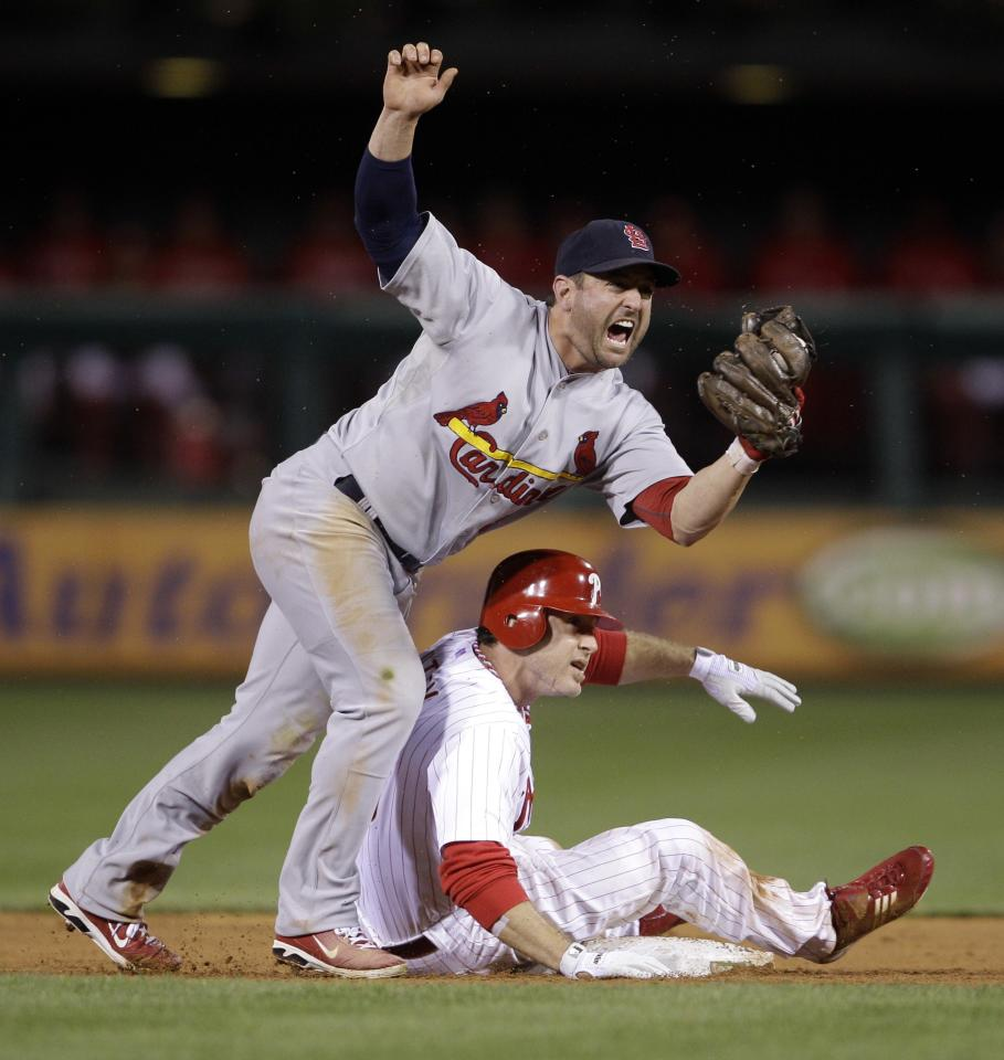 St. Louis Cardinals second baseman Nick Punto, left, reacts after Philadelphia Phillies' Chase Utley was thrown out at second base on the steal attempt during the sixth inning of baseball's Game 5 of the National League division series, Friday, Oct. 7, 2011, in Philadelphia. (AP Photo/Matt Slocum)