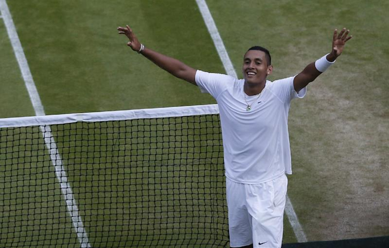Nick Kyrgios of Australia celebrates defeating Rafael Nadal of Spain in their men's singles match on Centre Court at the All England Lawn Tennis Championships in Wimbledon, London, Tuesday July 1, 2014