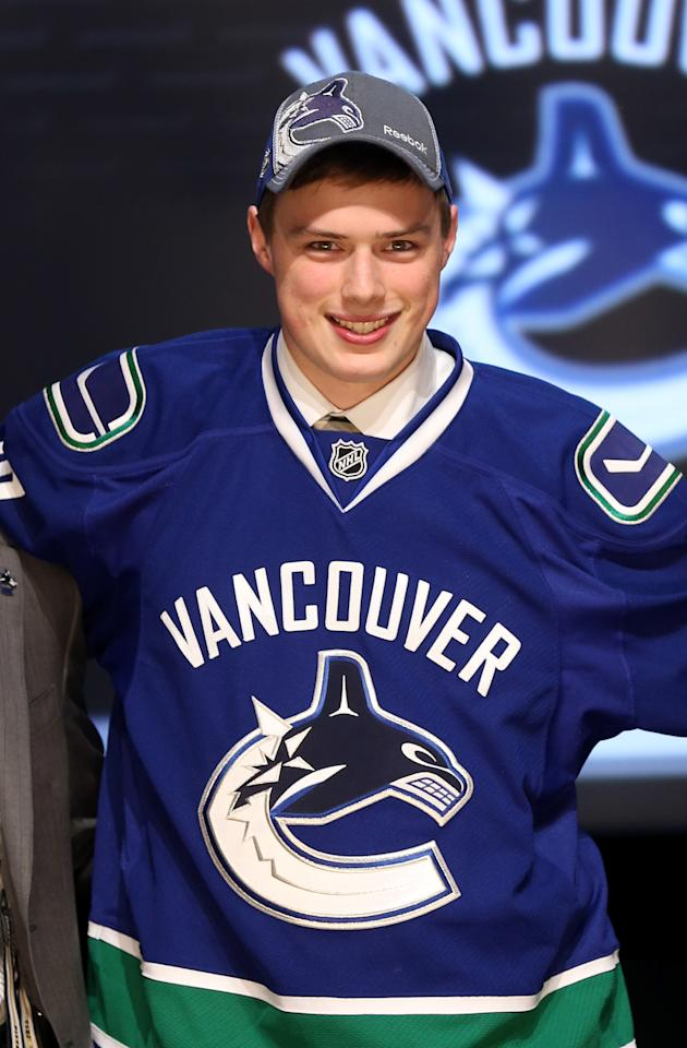 PITTSBURGH, PA - JUNE 22: Brendan Gaunce, 26th overall pick by the Vancouver Canucks, poses on stage during Round One of the 2012 NHL Entry Draft at Consol Energy Center on June 22, 2012 in Pittsburgh, Pennsylvania.  (Photo by Bruce Bennett/Getty Images)