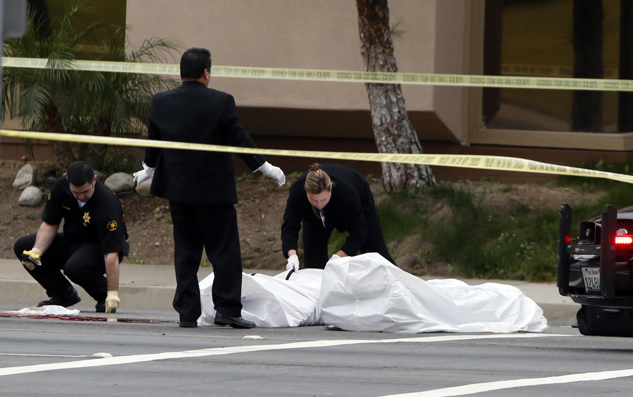 Orange County coroner's officials remove a body from the scene in Orange, Calif., Tuesday, Feb. 19, 2013. Police say a chaotic 25-minute shooting spree through Orange County left a trail of dead and injured victims before the shooter killed himself. Orange County sheriff's spokesman Jim Amormino say there are at least six crime scenes with three people, including the suspected gunman, dead and several others wounded. Tustin police Supervisor Dave Kanoti said the shootings started with an apparent carjacking just after 5 a.m. Tuesday in an unincorporated Ladera Ranch area of Orange County. (AP Photo/Jae C. Hong)