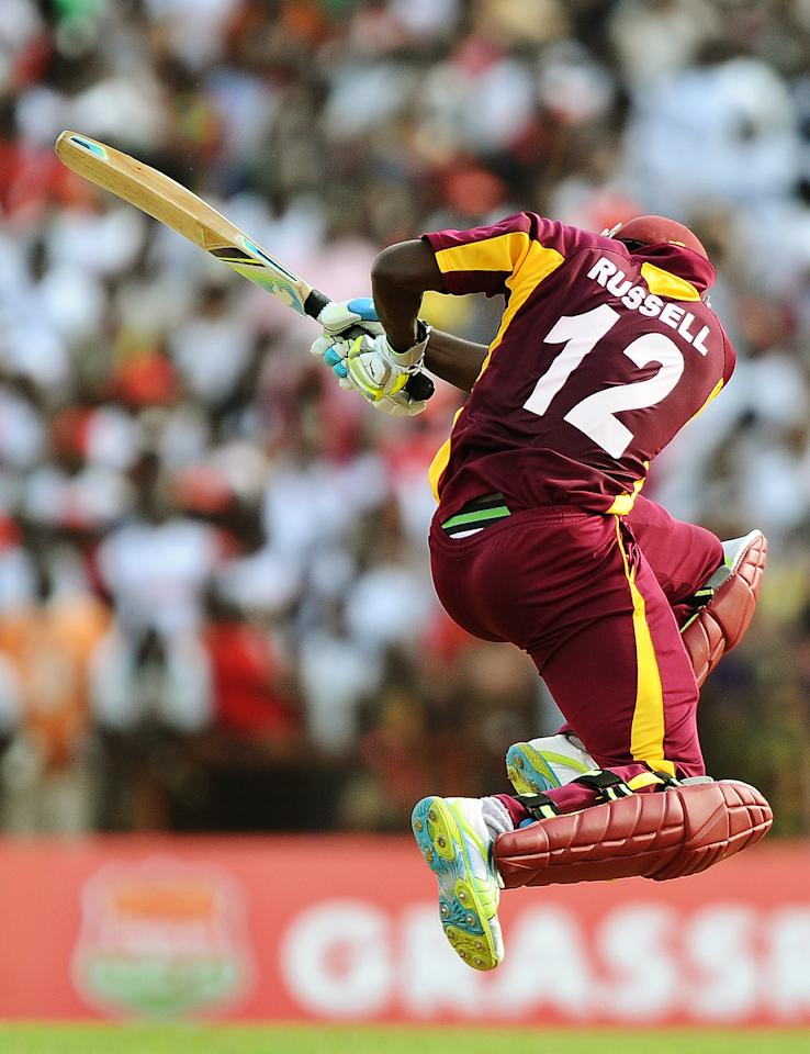 West Indies cricketer Andre Russell plays a shot during the third-of-five One Day International (ODI) matches between West Indies and Australia at the Arnos Vale Ground in Kingstown on March 20, 2012. Australia have scored 220/10 at the end of their innings. AFP PHOTO/Jewel Samad (Photo credit should read JEWEL SAMAD/AFP/Getty Images)