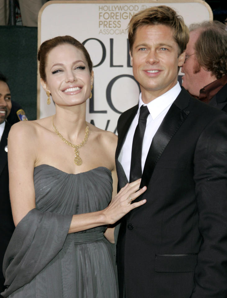 Actors Brad Pitt (R) and Angelina Jolie arrive at the 64th annual Golden Globe Awards in Beverly Hills, California January 15, 2007.     REUTERS/Lucy Nicholson (UNITED STATES)