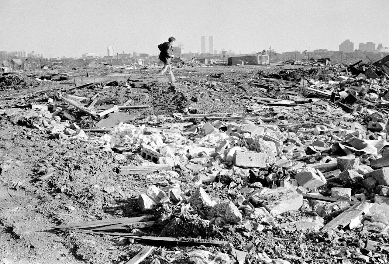 FILE - In this Dec. 5, 1975, file photo, a man walks over a rubble field in Jersey City, N.J., one of the locations where authorities searched for the body of missing former Teamster boss Jimmy Hoffa. (AP Photo, File)