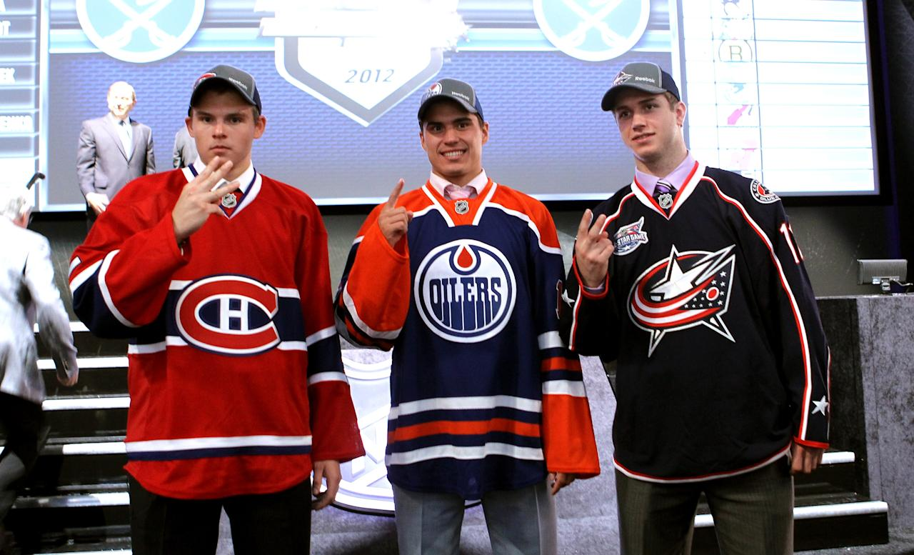PITTSBURGH, PA - JUNE 22: (L-R) Third overall pick by the Montreal Canadiens Alex Galchenyuk, first overall pick by the Edmonton Oilers Nail Yakupov and second overall pick by the Columbus Blue Jackets Ryan Murray pose during Round One of the 2012 NHL Entry Draft at Consol Energy Center on June 22, 2012 in Pittsburgh, Pennsylvania.  (Photo by Bruce Bennett/Getty Images)