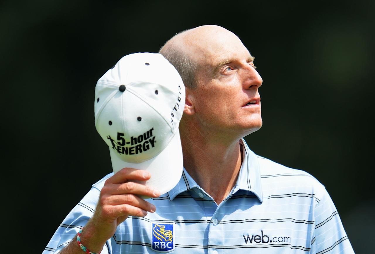 ROCHESTER, NY - AUGUST 08: Jim Furyk of the United States looks on from the ninth green after his five-under par 65 during the first round of the 95th PGA Championship on August 8, 2013 in Rochester, New York. (Photo by Stuart Franklin/Getty Images)