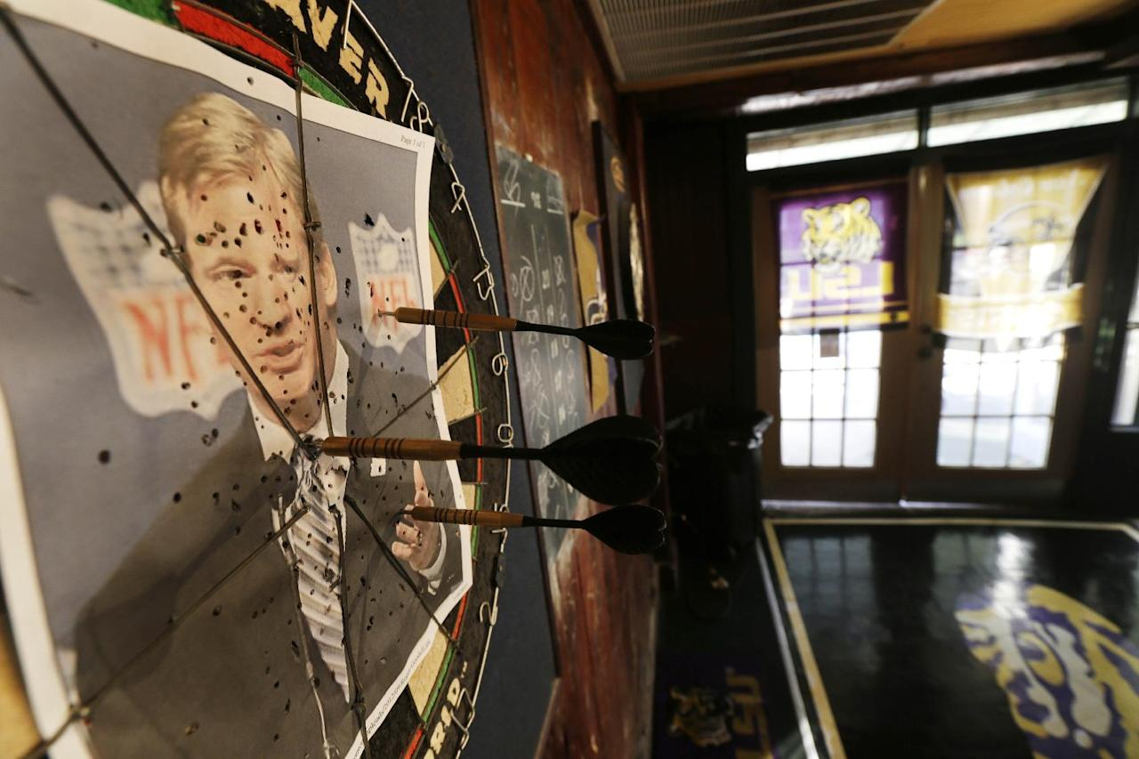 """A photo of NFL commissioner Roger Goodell is seen on a dartboard inside the Parkview Tavern in New Orleans, Friday, Jan. 25, 2013. New Orleans is celebrating the return of New Orleans Saints coach Sean Payton after a season's NFL banishment as a result of the """"Bountygate"""" scandal. But the good feeling does not extend to Goodell, who suspended Payton and other key players and coaches last year in the alleged pay-for-pain scheme. He is being ridiculed here with a vehemence usually reserved for the city's multitude of scandal-scarred politicians.(AP Photo/Gerald Herbert)"""