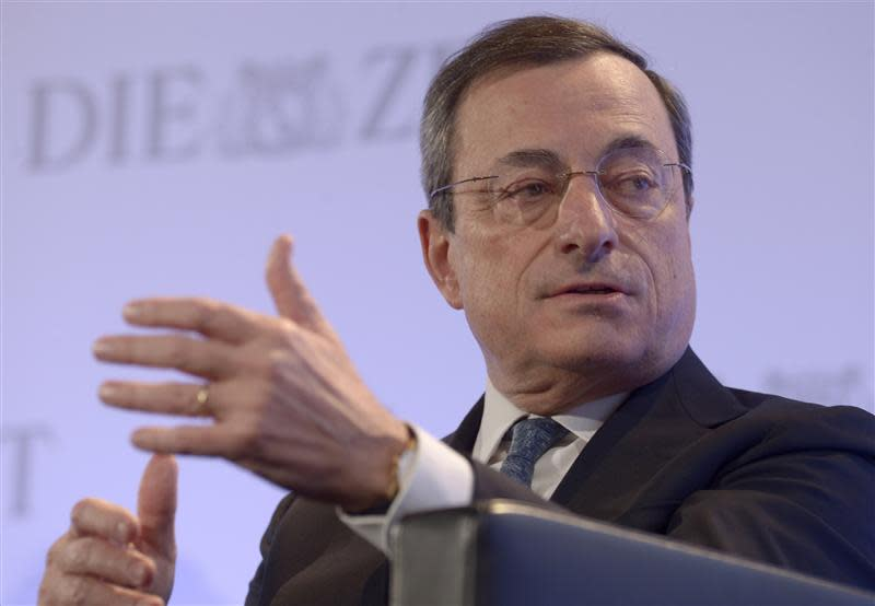 "ECB President Draghi gestures during his speech at the ""German Economic Forum"" in the St.Michaelis church in Hamburg"