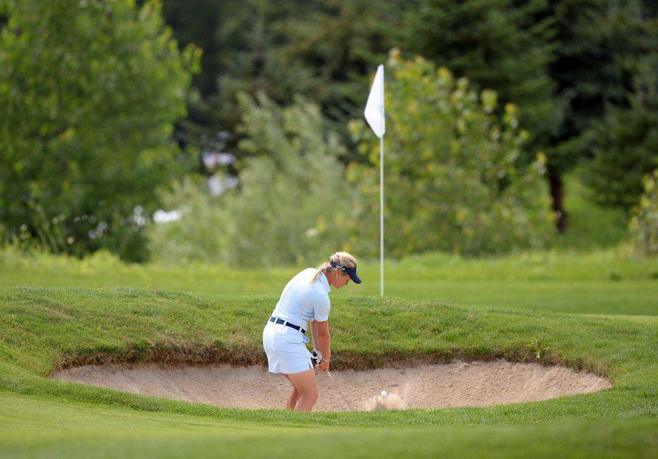 WATERLOO, CANADA - JULY 11: Suzann Pettersen of Norway hits out of the bunker on the 16th hole during round one of the Manulife Financial LPGA Classic at the Grey Silo Golf Course on July 11, 2013 in Waterloo, Canada. (Photo by Harry How/Getty Images)