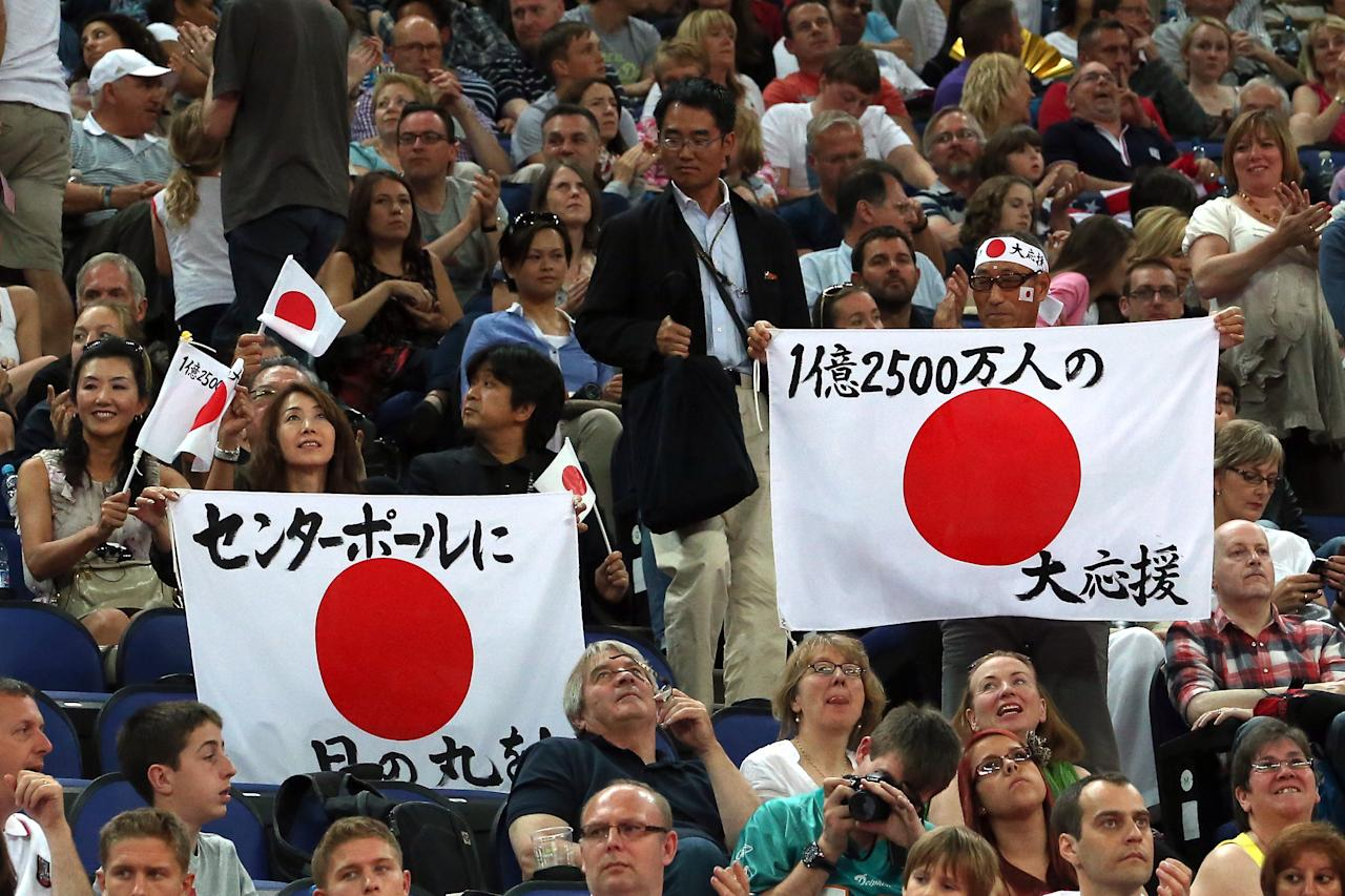LONDON, ENGLAND - JULY 28:  Japanese fans hold up signs during the Artistic Gymnastics Men's Team qualification on Day 1 of the London 2012 Olympic Games at North Greenwich Arena on July 28, 2012 in London, England.  (Photo by Ronald Martinez/Getty Images)