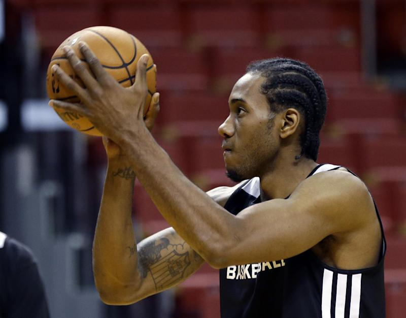 San Antonio Spurs' Kawhi Leonard shoots during basketball practice at the NBA Finals Wednesday, June 11, 2014, in Miami. The Spurs lead the Miami Heat 2-1 in the best-of-seven games series