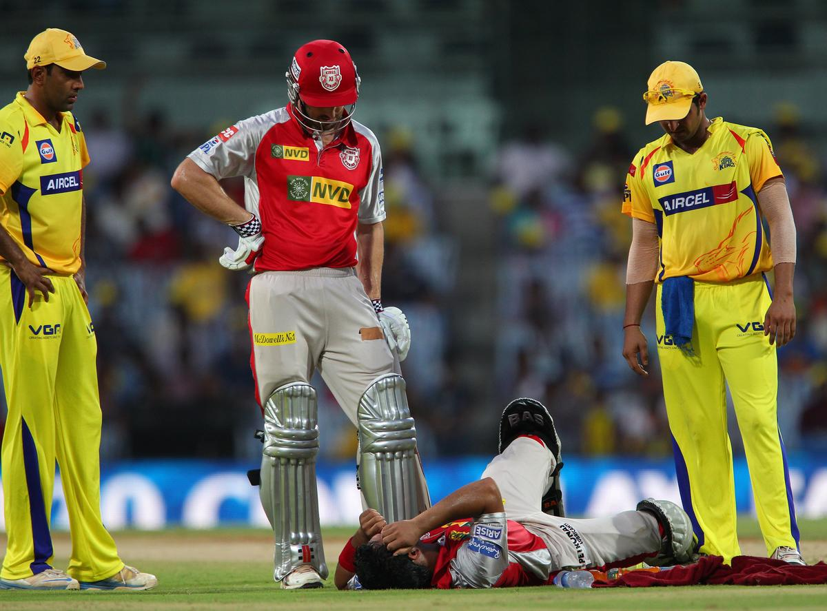 Mandeep Singh lies injured on the ground during match 45 of the Pepsi Indian Premier League between The Chennai Superkings and the Kings XI Punjab held at the MA Chidambaram Stadium in Chennai on the 2nd May 2013..Photo by Ron Gaunt-IPL-SPORTZPICS   .. .Use of this image is subject to the terms and conditions as outlined by the BCCI. These terms can be found by following this link:..http://www.sportzpics.co.za/image/I0000SoRagM2cIEc