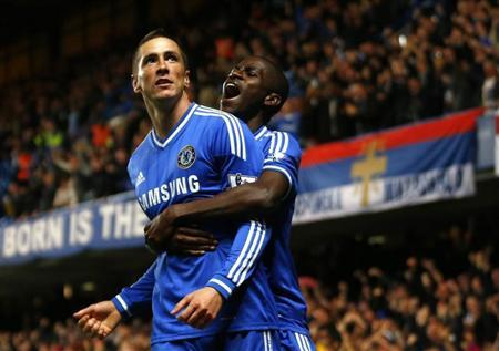 Chelsea's Fernando Torres celebrates with team mate Ramires after scoring a goal against Manchester City during their English Premier League soccer match at Stamford Bridge in London