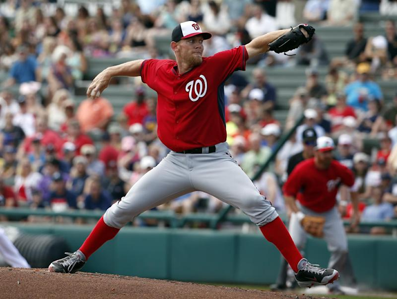 Washington Nationals starting pitcher Stephen Strasburg (37) throws in the second inning of a spring exhibition baseball game against the Atlanta Braves, Tuesday, March 4, 2014, in Kissimmee, Fla