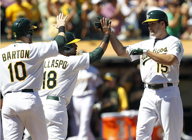 Colon ends long winless skid, A's beat Astros