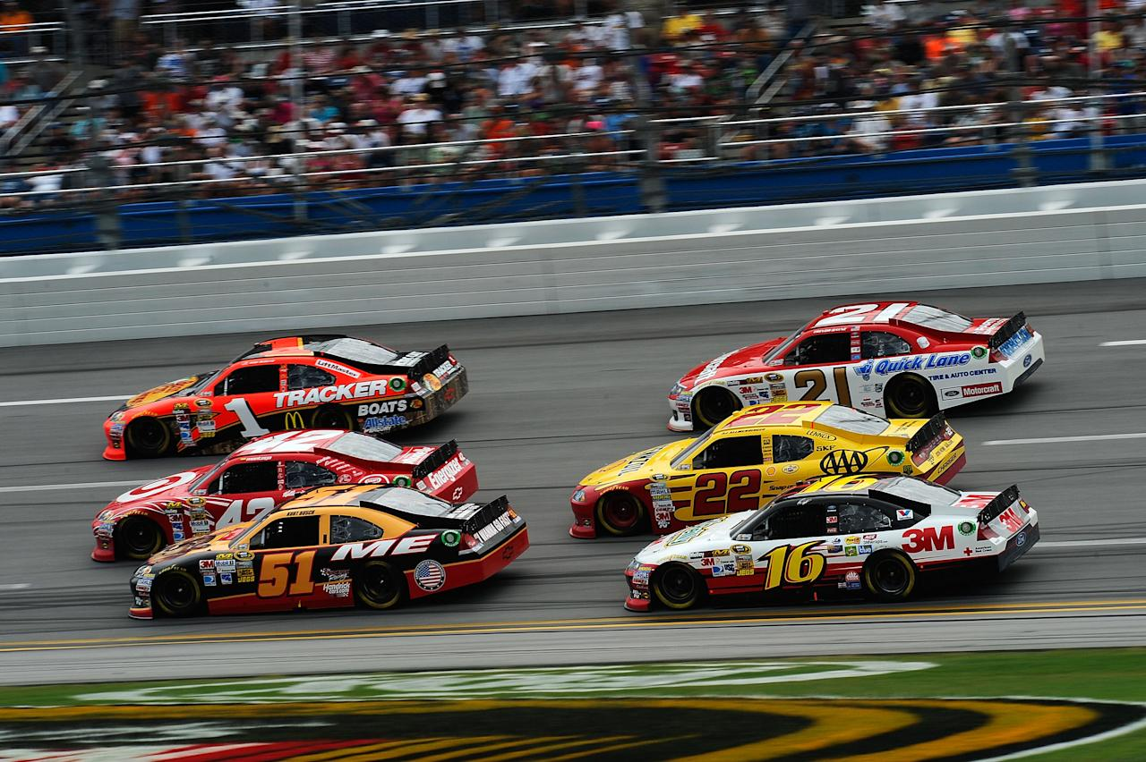TALLADEGA, AL - MAY 06:  Kurt Busch, driver of the #51 Phoenix Construction Services Chevrolet, Juan Montoya, driver of the #42 Target/Kraft Chevrolet, Jamie McMurray, driver of the #1 Bass Pro Shops/Tracker Boats Chevrolet, Greg Biffle, driver of the #16 3M/O'Reilly Auto Parts Ford, AJ Allmendinger, driver of the #22 Shell/Pennzoil-AAA Dodge, and Trevor Bayne, driver of the #21 Motorcraft/Quick Lane Tire & Auto Center Ford, race during the NASCAR Sprint Cup Series Aaron's 499 at Talladega Superspeedway on May 6, 2012 in Talladega, Alabama.  (Photo by Jared C. Tilton/Getty Images)
