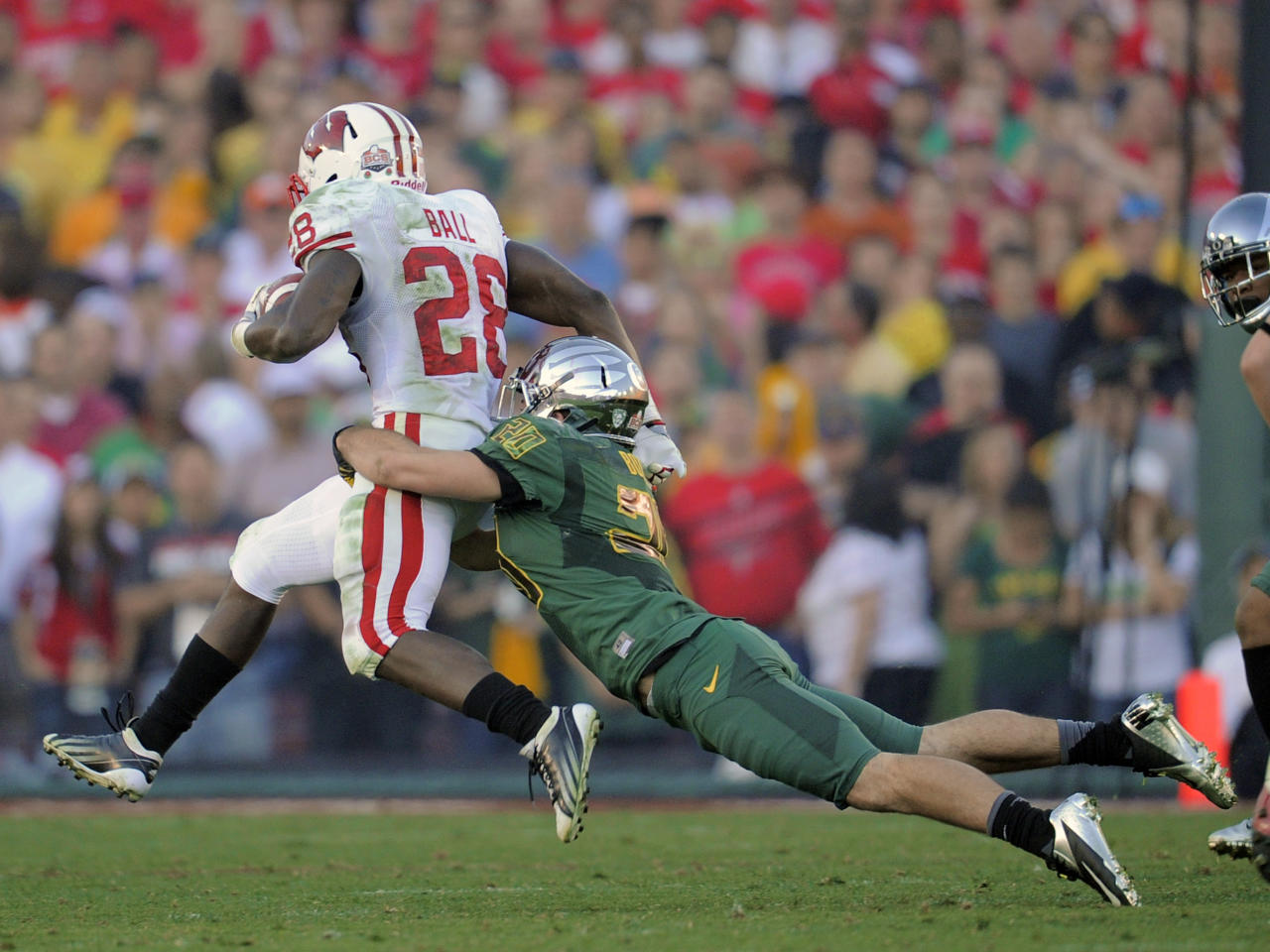 Oregon's John Boyett (20) stops Wisconsin running back, Montee Ball (28) during the second half of the Rose Bowl NCAA college football game, Monday, Jan. 2, 2012, in Pasadena, Calif. (AP Photo/Mark J. Terrill)