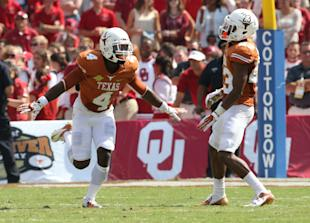 Daje Johnson, No. 4, helped keep the Longhorns in front with an 85-yard punt return for a TD. (USA Today)